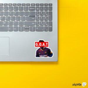 استیکر لپ تاپ G.O.A.T روی لپتاپ