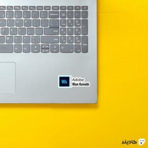 استیکر لپ تاپ ادوبی وان کنوبی روی لپتاپ