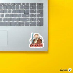 استیکر لپ تاپ کنوبی روی لپتاپ