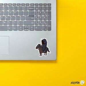 استیکر لپ تاپ سوار سیاه روی لپتاپ