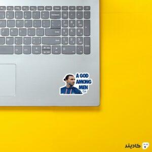استیکر لپ تاپ خدایی در میان انسانها روی لپتاپ