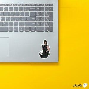 استیکر لپ تاپ پوستر داریل روی لپتاپ