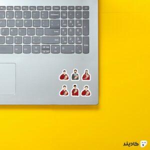 استیکر لپ تاپ شخصیتهای سریال مانی هیست روی لپتاپ