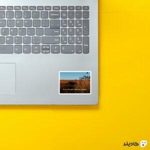 استیکر لپ تاپ پوستر فیلم با تایپوگرافی روی لپتاپ