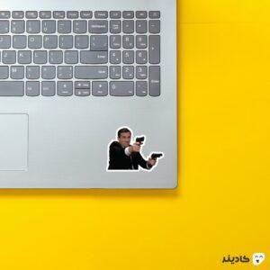 استیکر لپ تاپ سریال آفیس - مایکل با تفنگ روی لپتاپ