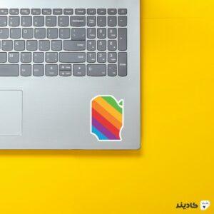 استیکر لپ تاپ تیم کوک - لوگوی رنگین کمانی اپل روی لپتاپ