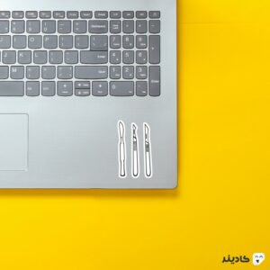 استیکر لپ تاپ استیکر لپ تاپ پزشکی - چاقوی کوچک جراحی روی لپتاپ